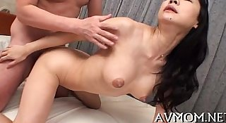 Sexy oriental mom strip tease